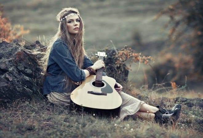 female hippie with acoustic guitar