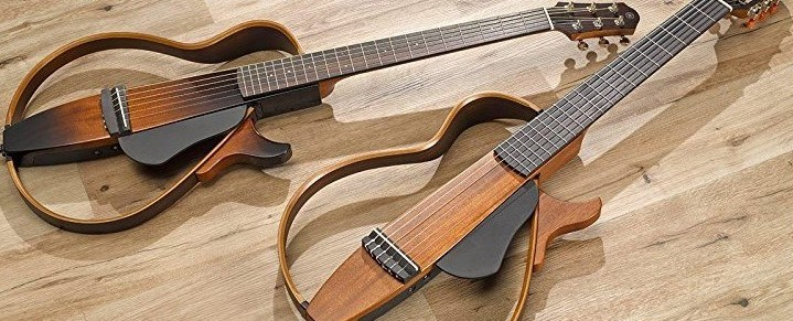 Two Yamaha SLG Silent Guitars on Wooden Floor