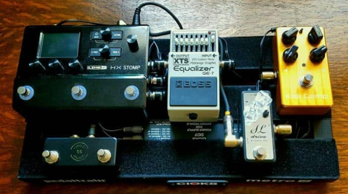 Davis Baders travel pedalboard with effects pedals on it