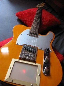 Electric guitar with pad