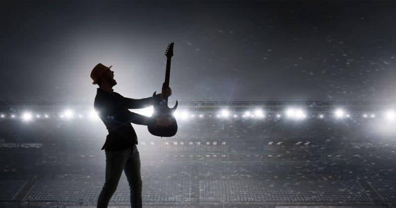 Performer On Stage With His $2000 Electric Guitar