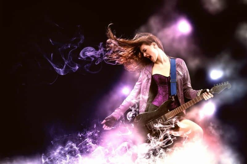 Young Female Rock Star Playing The Electric Guitar