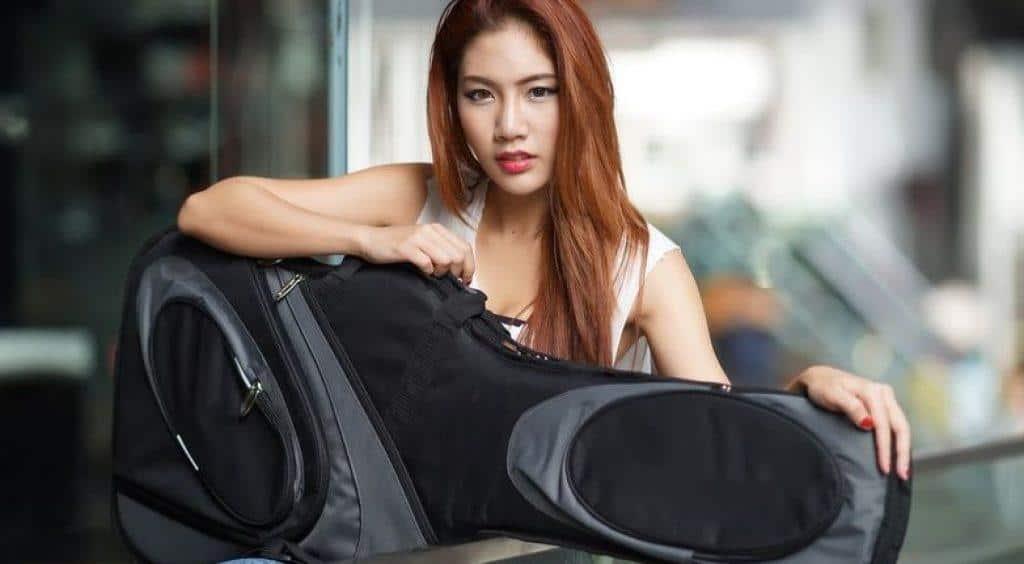 Female Guitarist Holding Electric Guitar Gig Bag