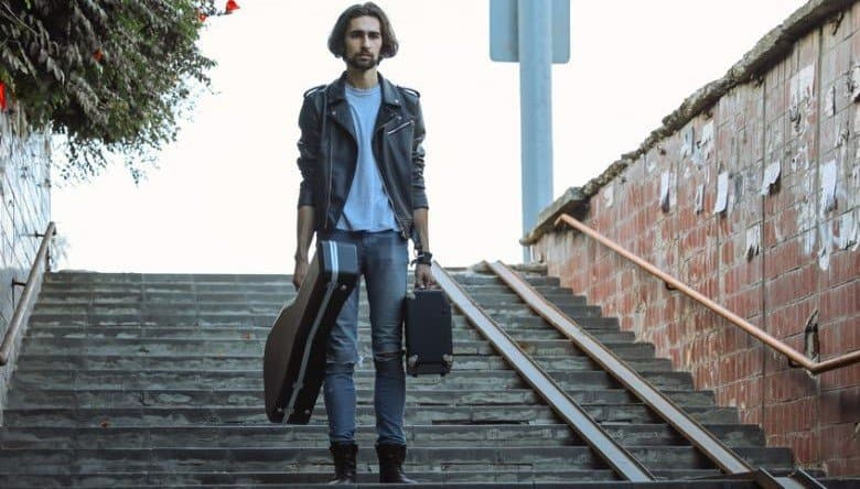 Guitarist Carrying Hard Guitar Case