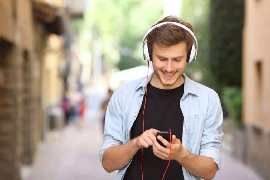 Man wearing over ear headphones