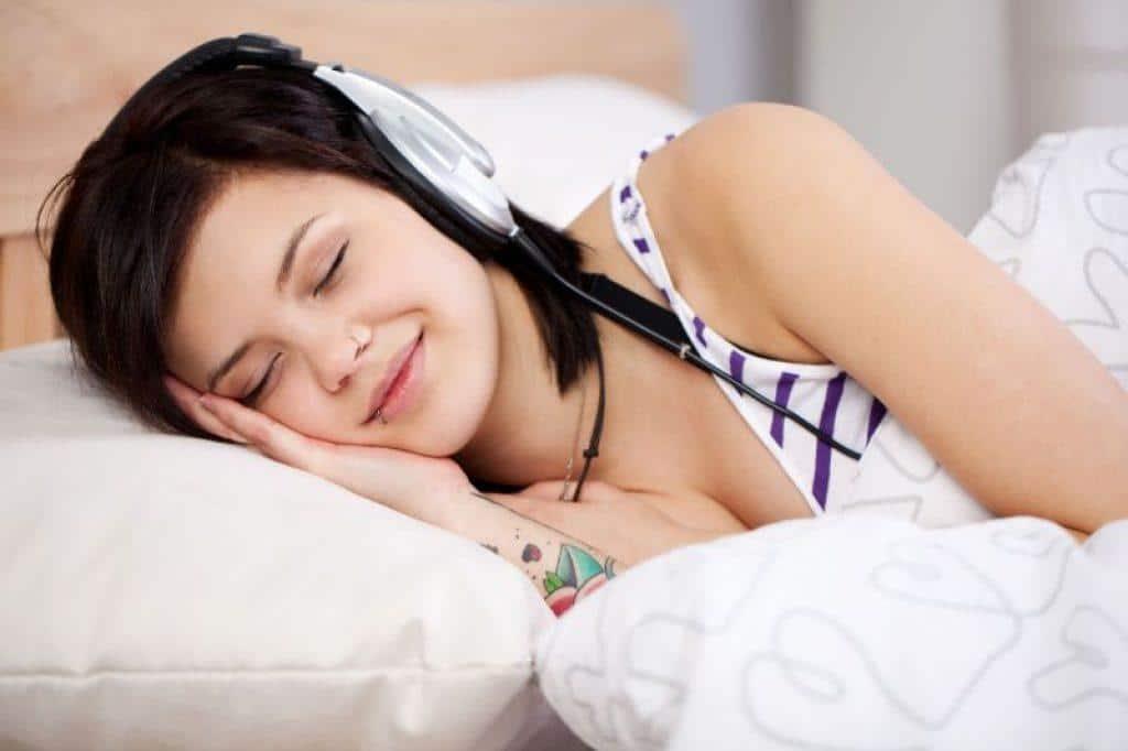 woman sleeping with headphones on