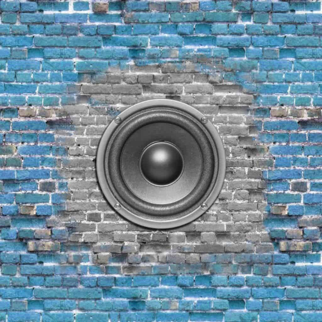 Cool In-Wall Speaker on blue brick background