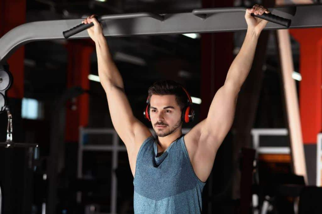 man working out wearing over ear headphones
