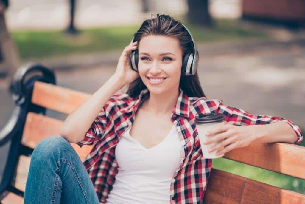 woman wearing bluetooth headphones