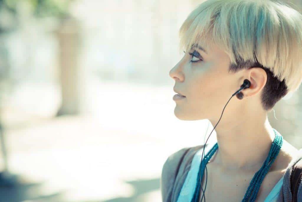 woman wearing earbuds