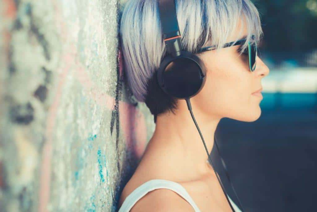 woman wearing over ear headphones