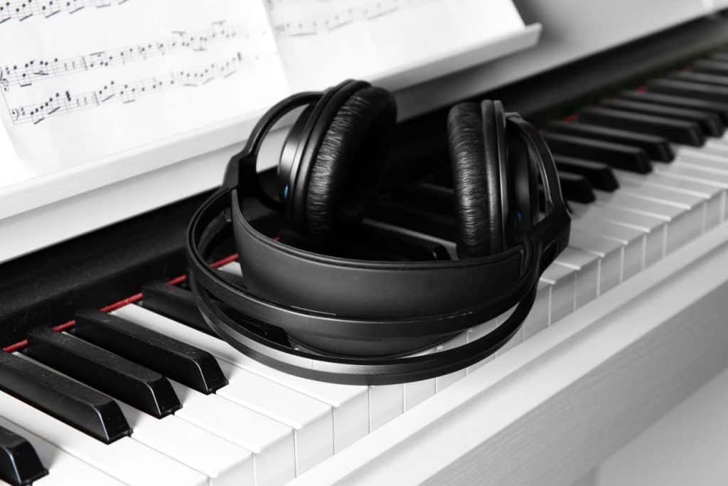 good quality headphones sitting on a piano