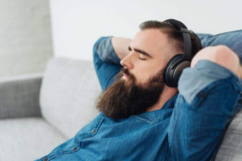 man wearing closed back headphones