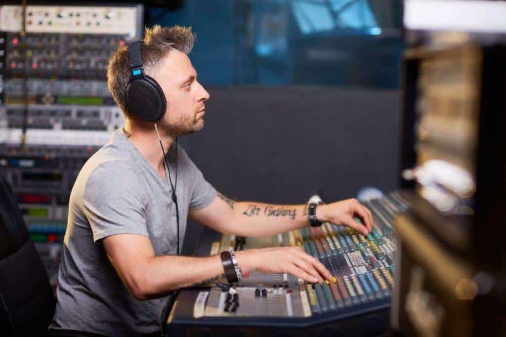 man wearing planar magnetic headphones