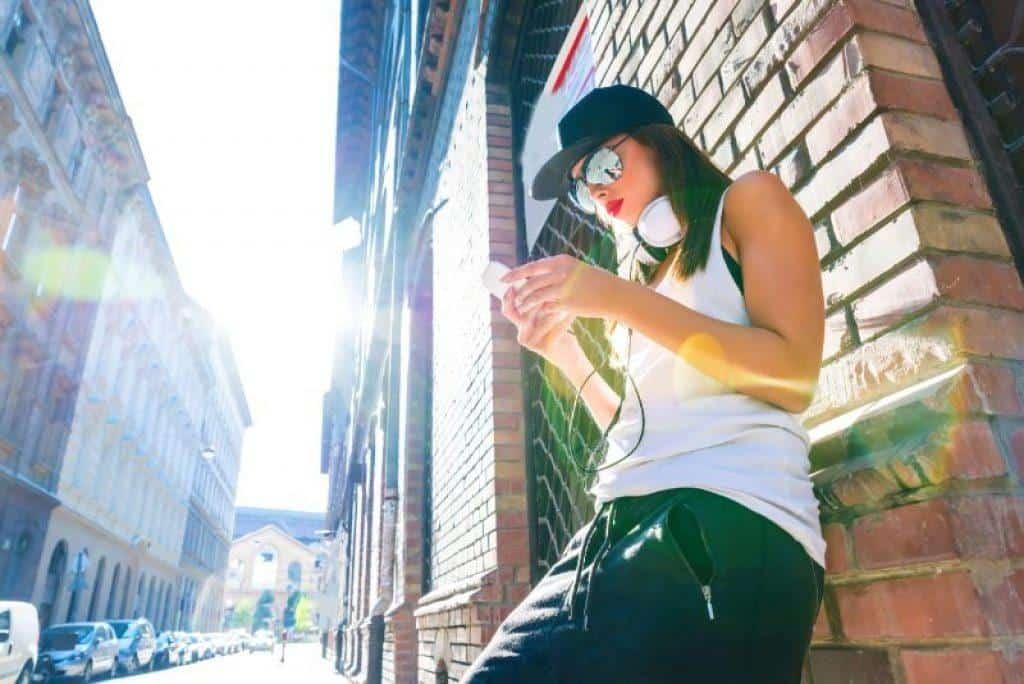 woman in hip hop clothes wearing hip hop headphones