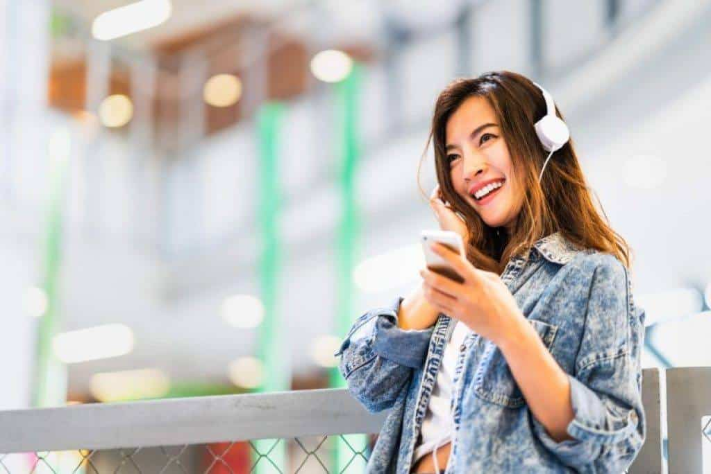 woman wearing quality headphones worth around $200