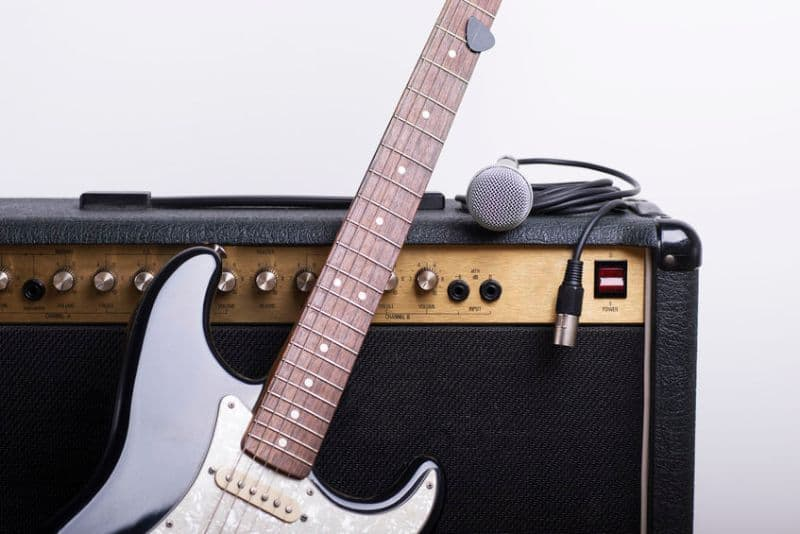 Electric Guitar Leaning on Amplifier