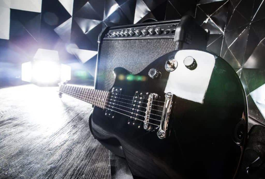 Electric Guitar Plugged into Tube Amplifier