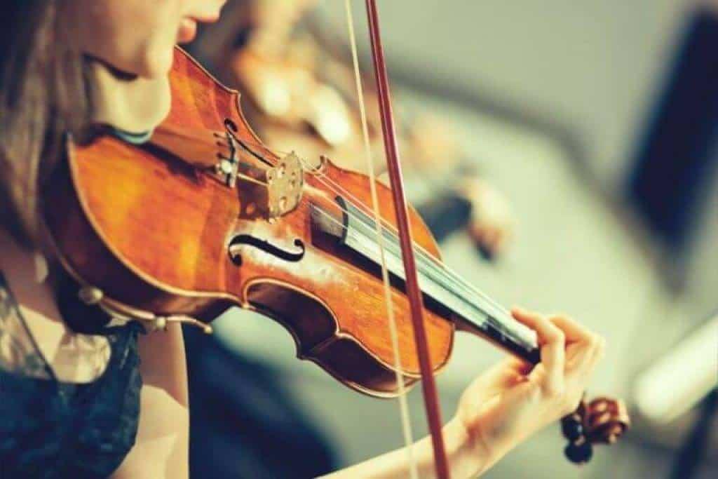Female Musician Playing $1000 Violin