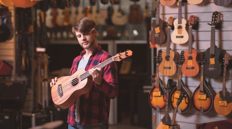 Man in Music Shop Choosing a Ukulele