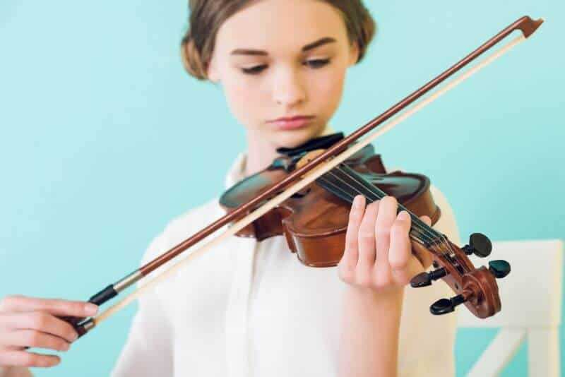 Young Musician Playing Inexpensive Violin