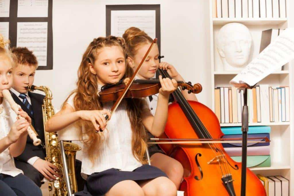 Children Learning to Play Violin and Cello