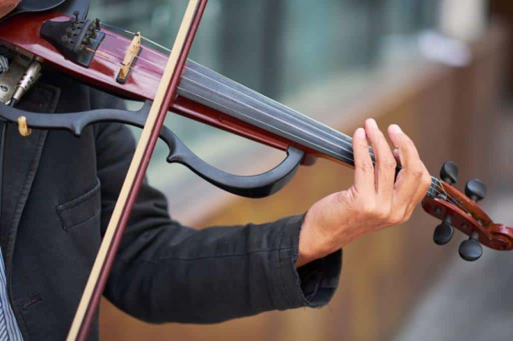 man playing electric violin