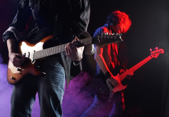 Guitarists playing on stage